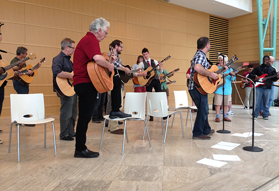 Guitar players in the Wintergarden at the Schuster Center