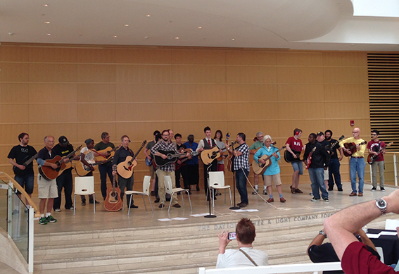Guitar players perform on the steps in the Wintergarden at the Schuster Center