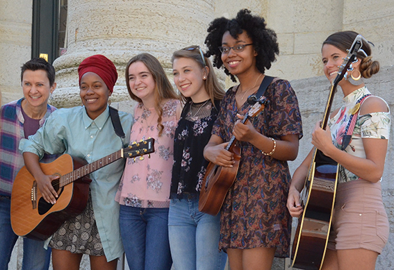 Women Who Rock performers pose for a picture.