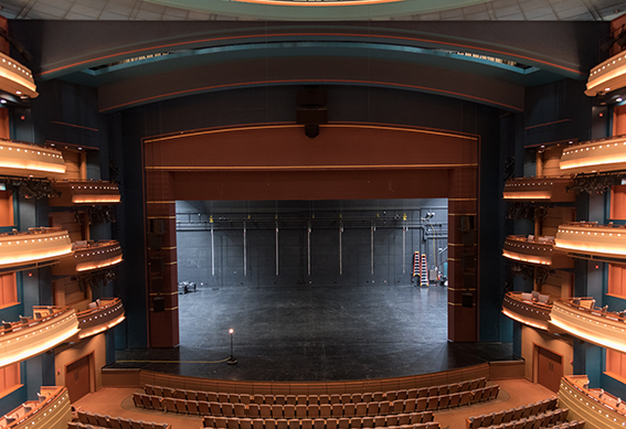 Mead Theatre stage with curtain opened as seen from the center balcony